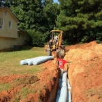 Installing Drainfield for Repair to System